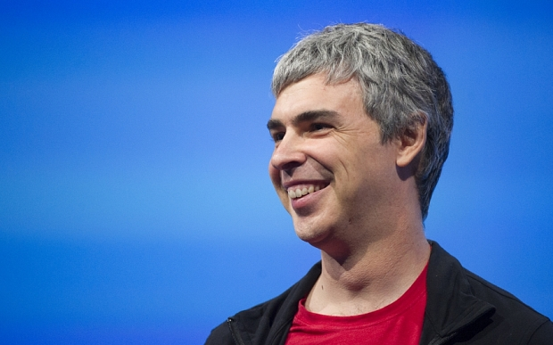 Larry Page, co-founder and chief executive officer at Google Inc., smiles during the Google I/O Annual Developers Conference in San Francisco, California, U.S., on Wednesday, May 15, 2013. Page disclosed a health condition that can result in hoarse speech and labored breathing, though according to doctors won't impede him from running the Web-search provider. Photographer: David Paul Morris/Bloomberg *** Local Caption *** Larry Page